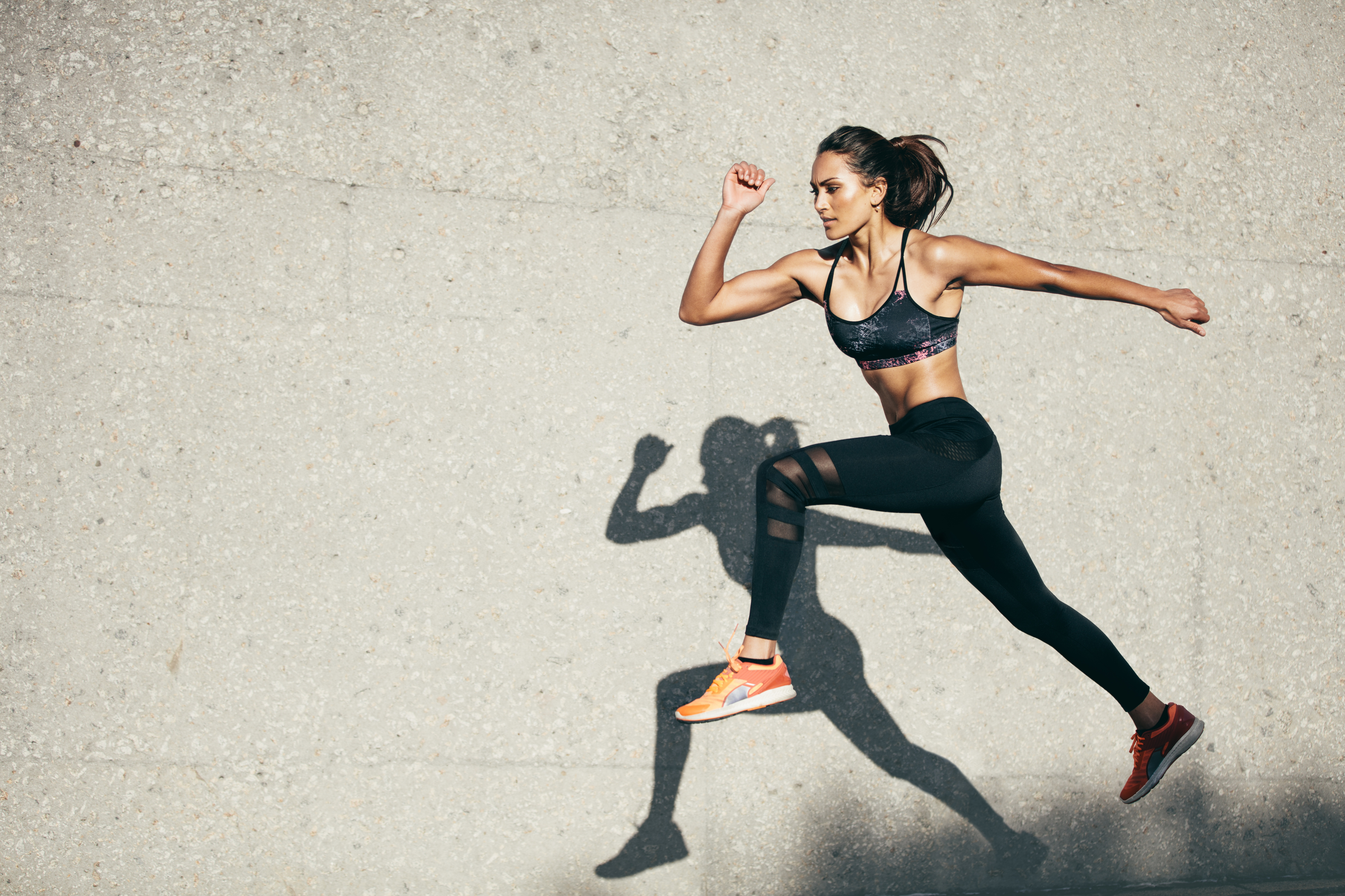 Fit-young-woman-jumping-and-running-853930556_8660x5773 (1)